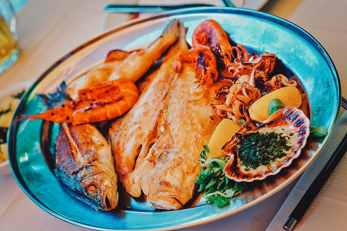 Seafood platter with grilled fish, squid, shrimp, and scallops