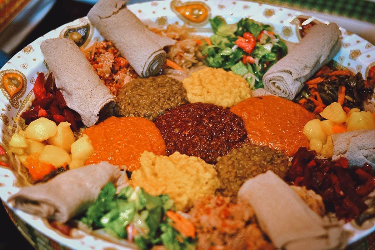 Yetsom beyaynetu, a colorful platter of many Ethiopian dishes