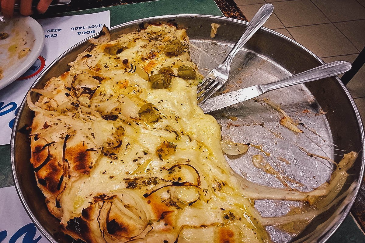Half-eaten fugazza or Argentine pizza from a restaurant in Buenos Aires