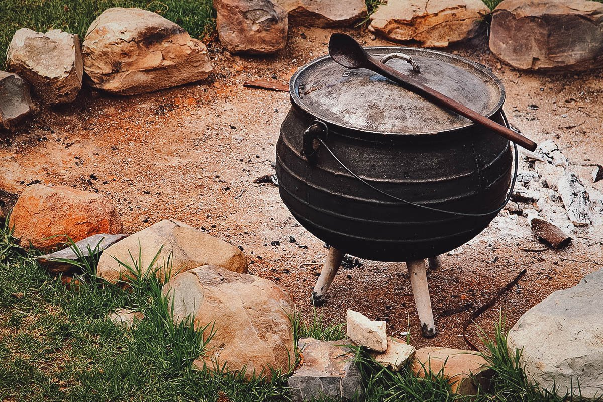 Potjie, a cast iron pot used to cook potjiekos over hot coals