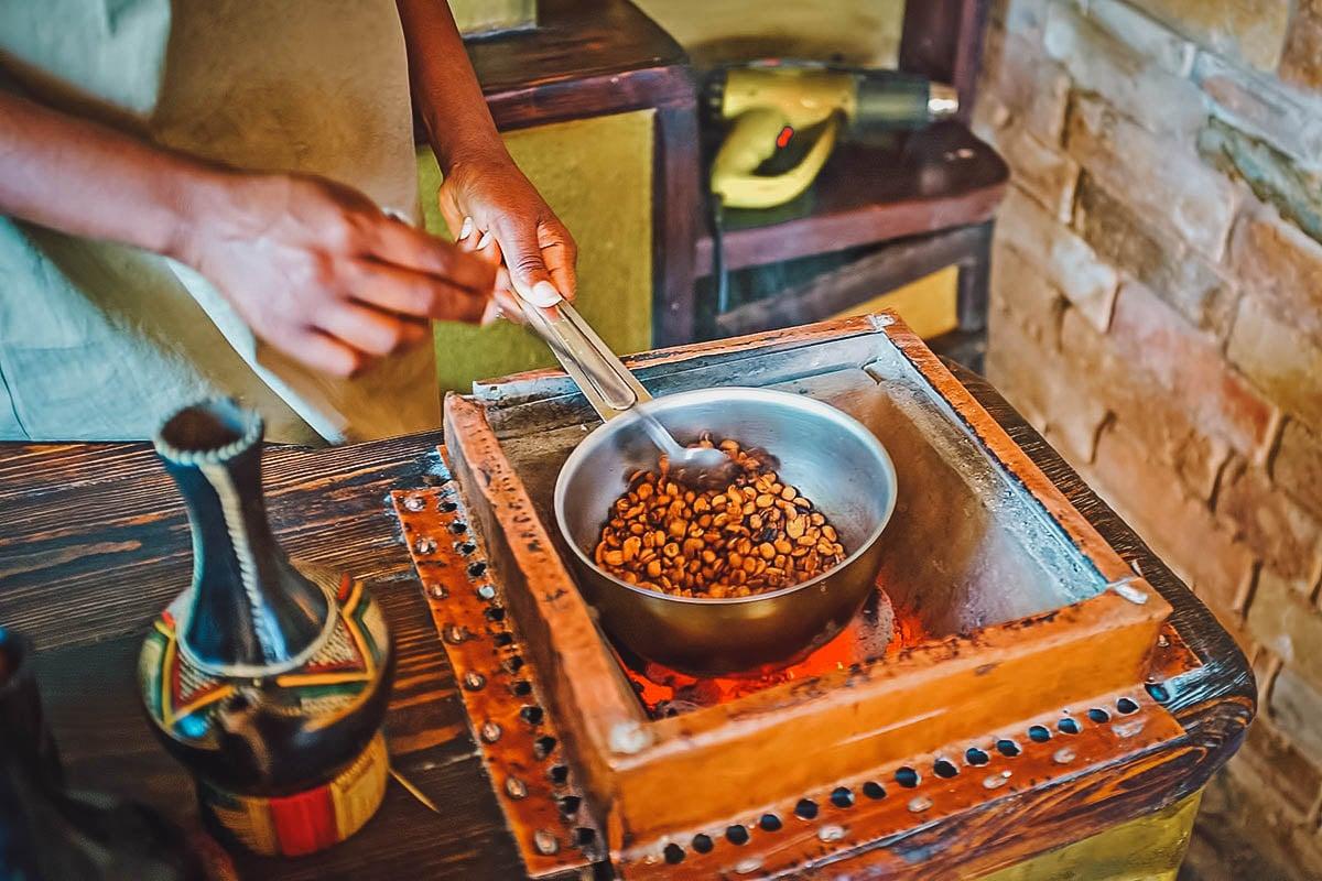 Female coffee maker roasting Ethiopian coffee