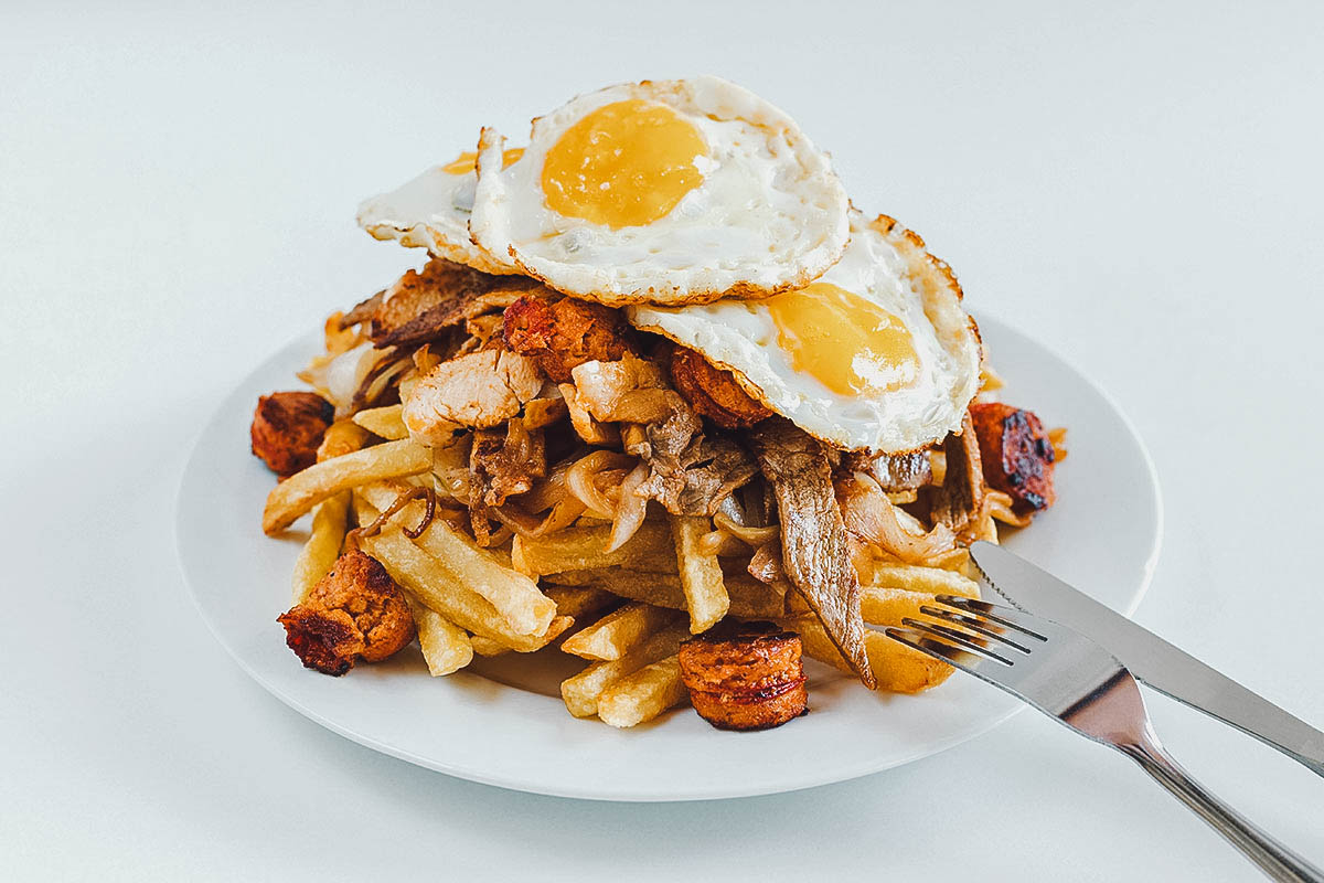 Chorrillana topped with fried egg
